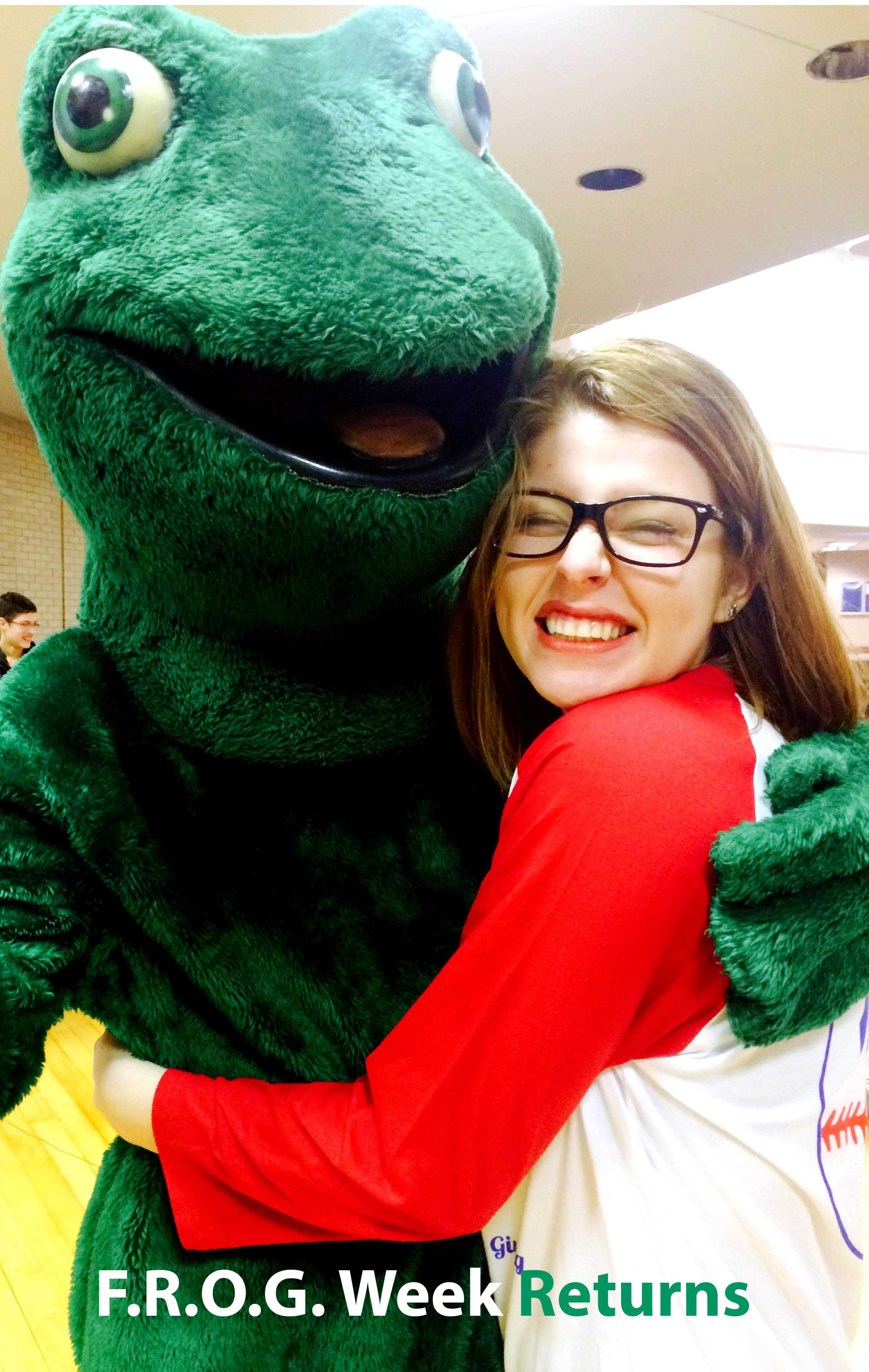 Brittnee Tapia hugging the Frog and showing her Summit Love. In the cafeteria February 20,2015