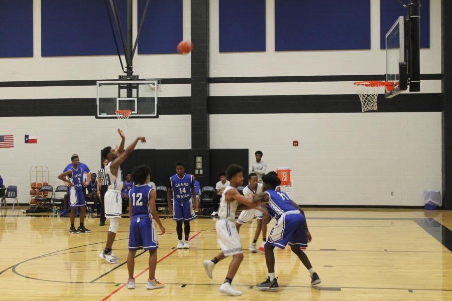Varsity boys' basketball team pushes through